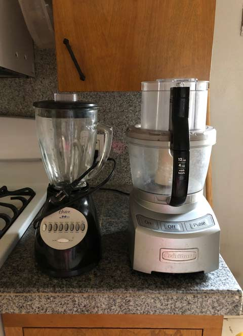 Oster brand blender and a Cuisinart 12-cup food processor
