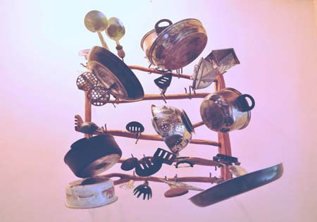 Kitchen cookware on a wooden rack
