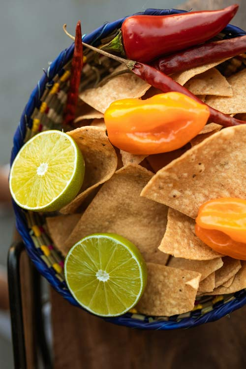 Zesty chips mixed with peppers and lime can help create some amazing nachos.