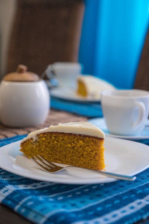 A slice of frosted carrot cake