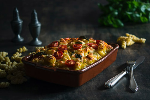 Image is of a pasta casserole with tomatoes.