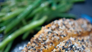 Close-up of cooked salmon and green beans.